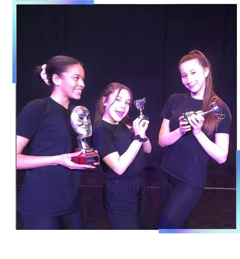 three girls holding trophies